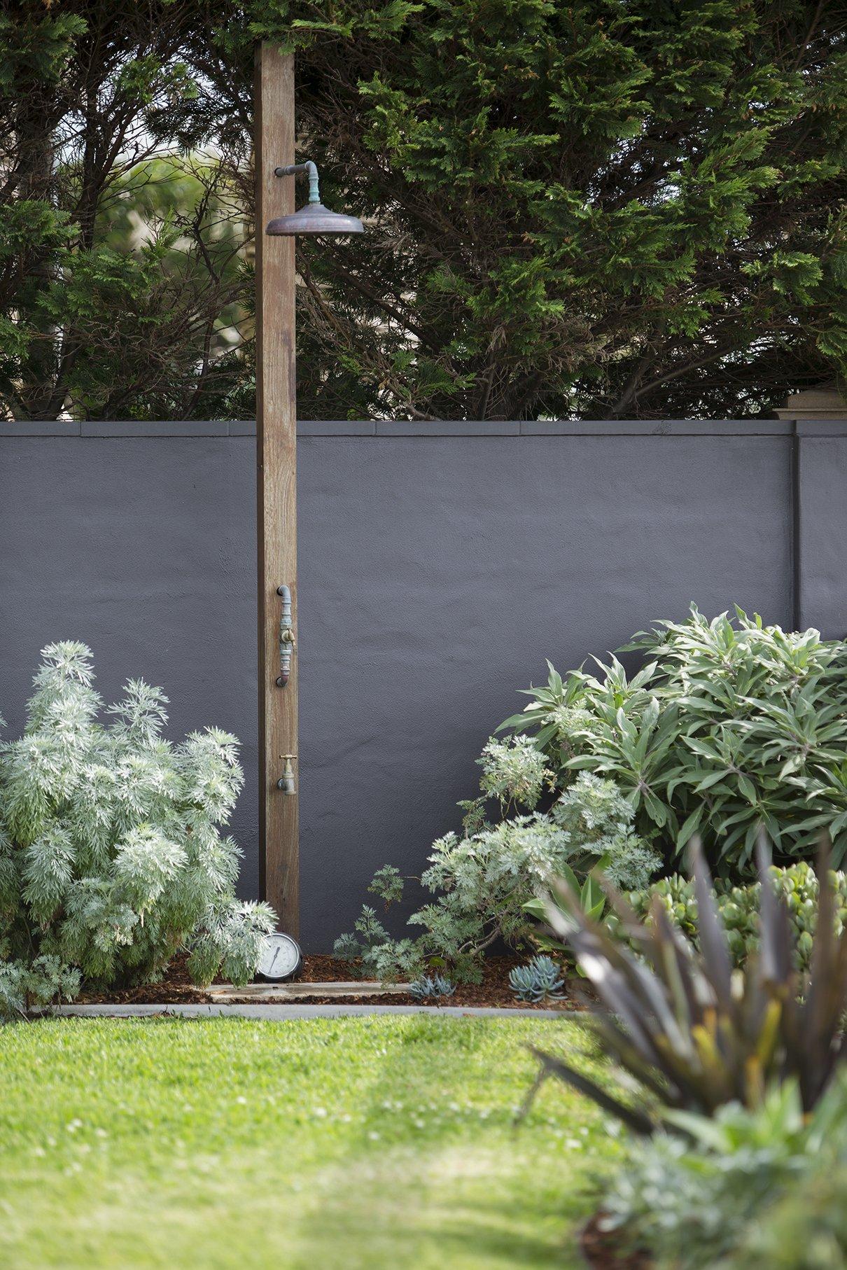 Outdoor shower in landscaped garden