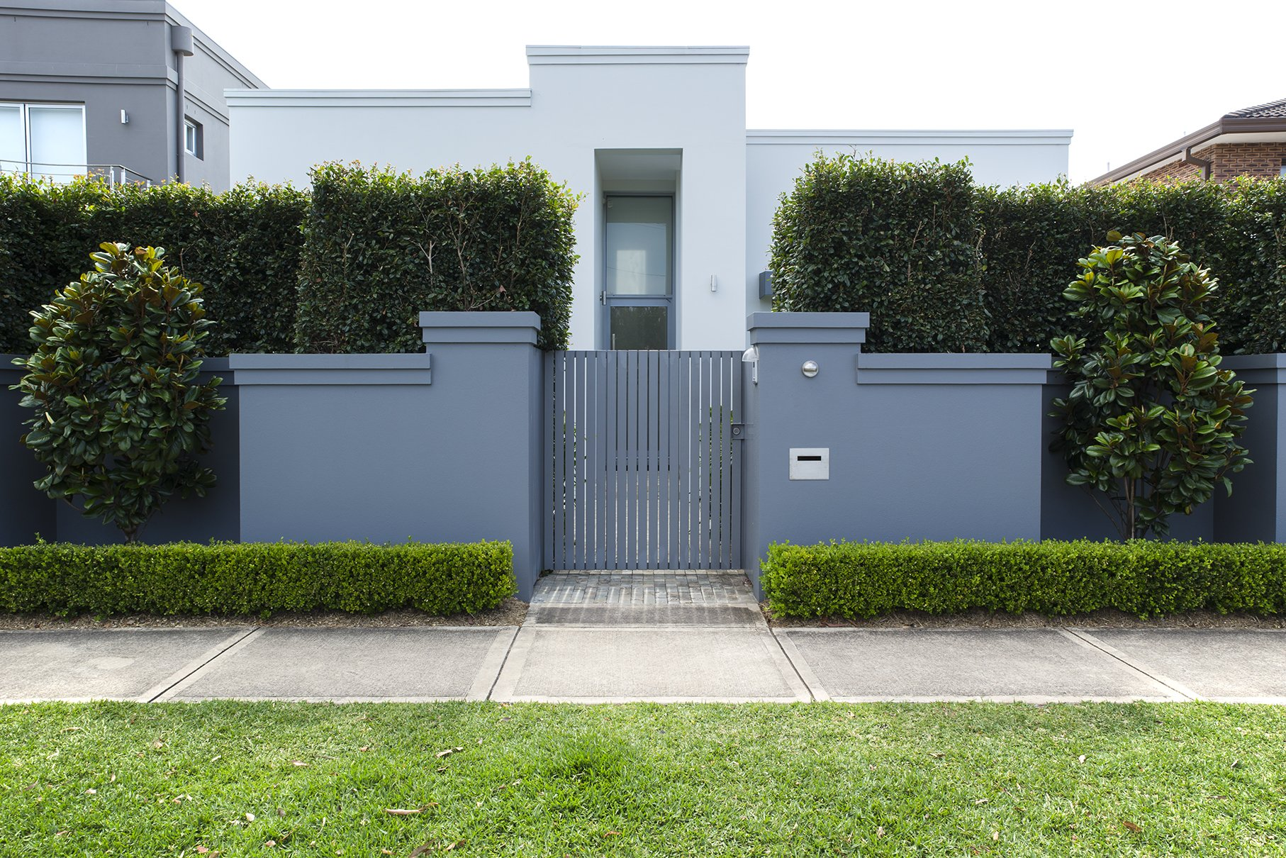 Exterior of a grey toned house with a detailed garden design