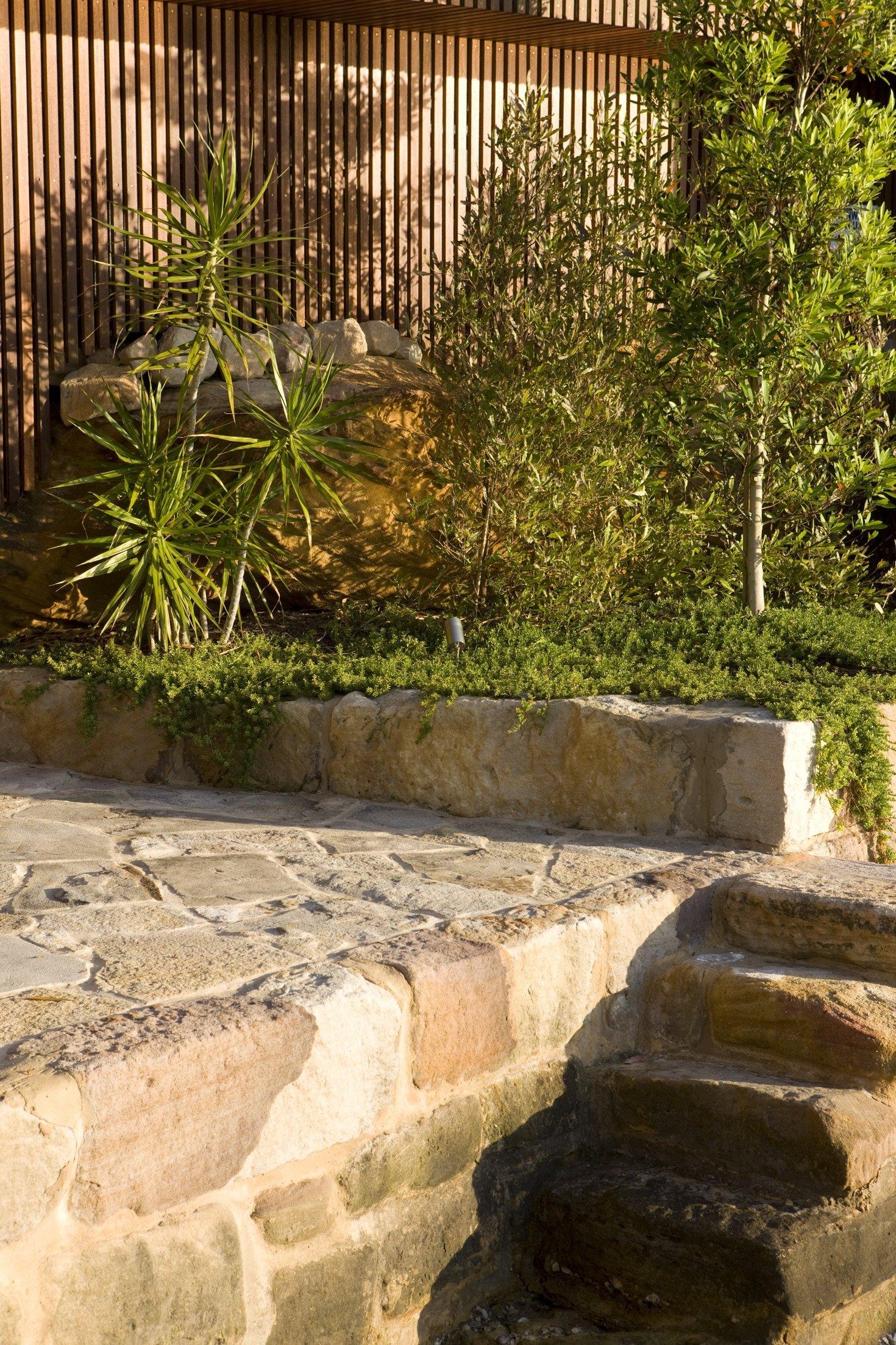 Sandstone stairs in a garden design