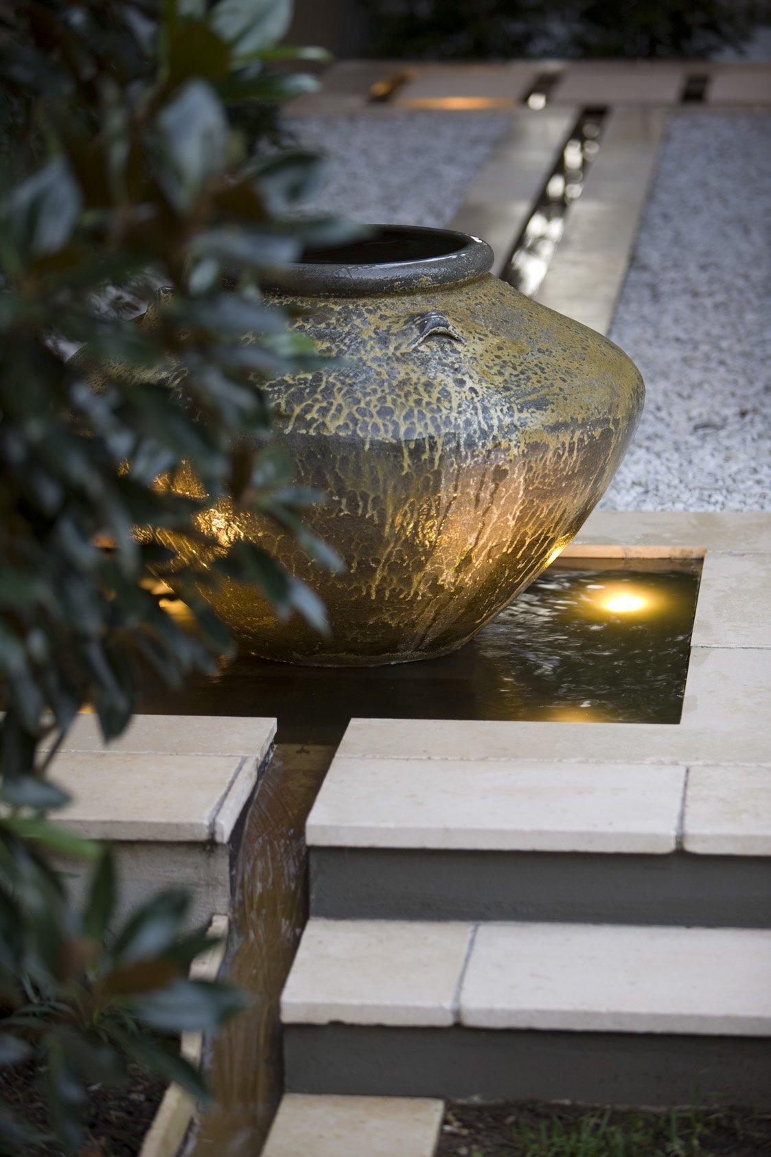 Water fountain in paved garden design