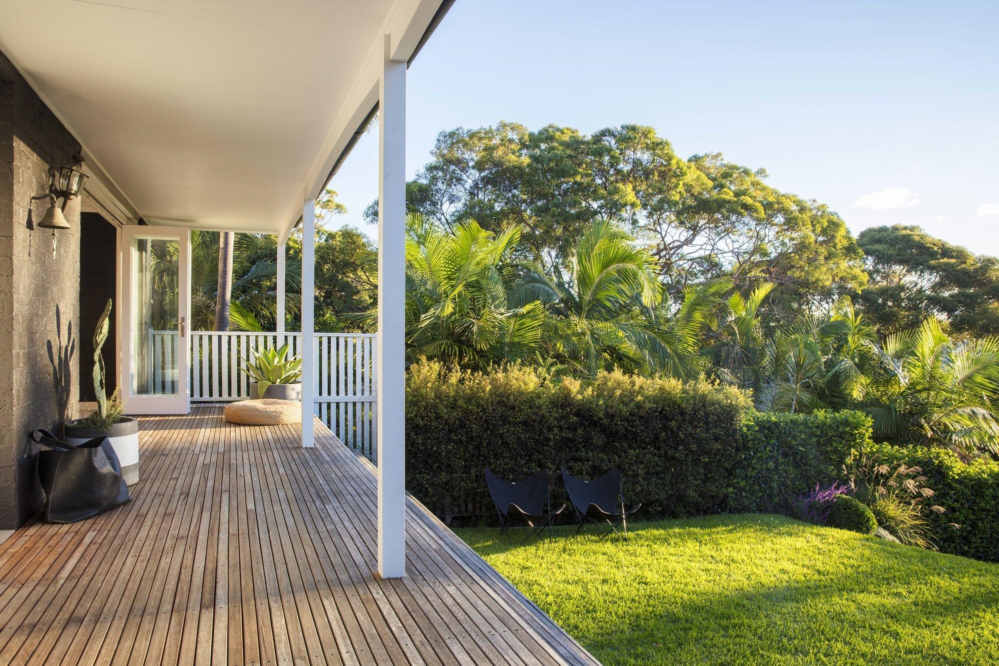 A timber deck onlooking a garden designed backyard