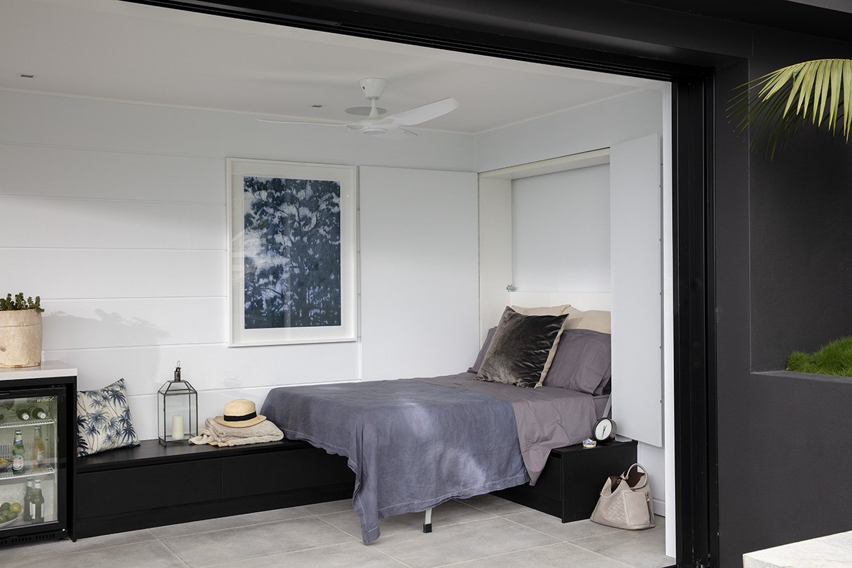 Grey and black themed guest house with mini bar and bedding